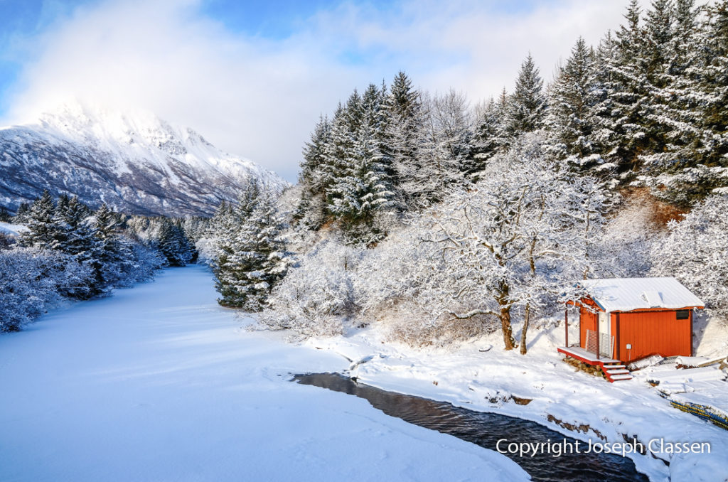 A beautiful winter landscape photo of a cabin along the Busking River, Kodiak Island, Alaska. Joseph Classen.